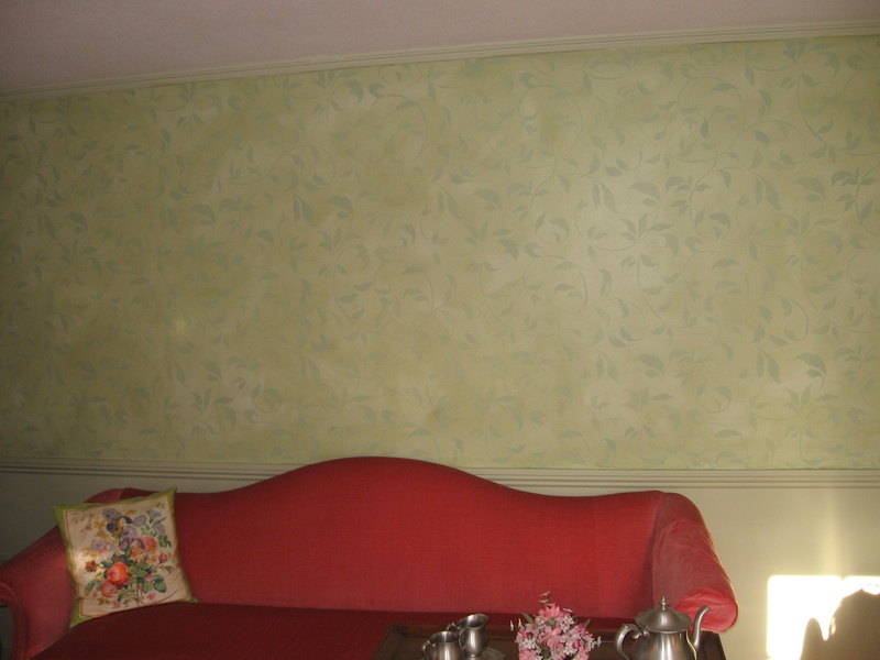 A tea Stain Finish with blue green over light green, wall stencil of a endless vine